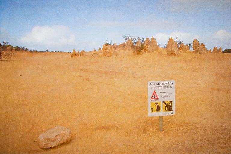 Sign warning of Falling Rock Risk in the Pinnacles Desert, Nambung National Park