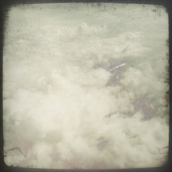 Clouds TTV - a grungy muted texture of clouds with faux Through The Viewfinder (TTV) edges
