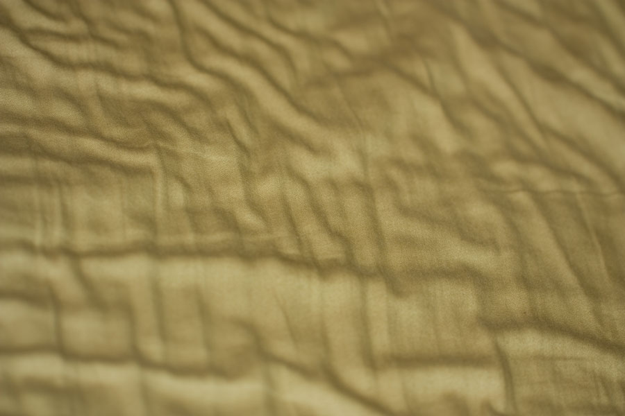 Fabric Waves - Thumbnail of gentle folds & waves in olive green fabric